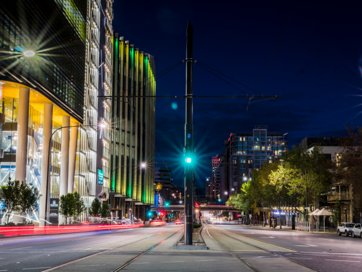 night time shot of north terrace tram line, outside Adelaide Health and Medical Sciences building and UniSA building