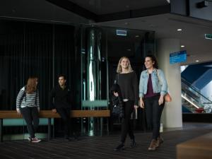 Two students walking through ground floor foyer of Adelaide Health and Medical Sciences building
