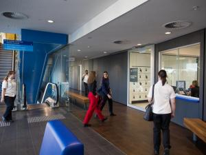 Students and staff walking through the foyer at the entrance of the Adelaide Health Simulation